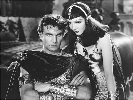 Claudette Colbert's Cleopatra seduces a stony Mark Anthony (Henry Wilcoxon)