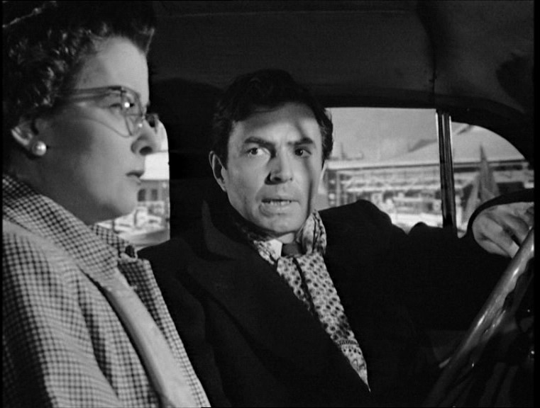 Martin Donnelly (James Mason) makes his threat to Lucia (Joan Bennett)