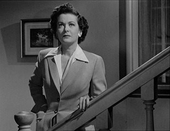 Joan Bennett as Lucia Harper in her suburban home