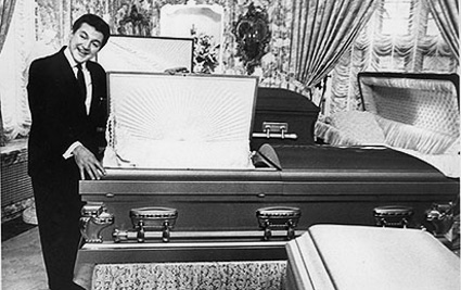 Liberace as a coffin salesman