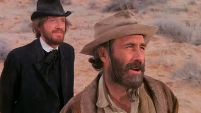 David Warner and Jason Robard as Rev. Sloane and Cable Hogue